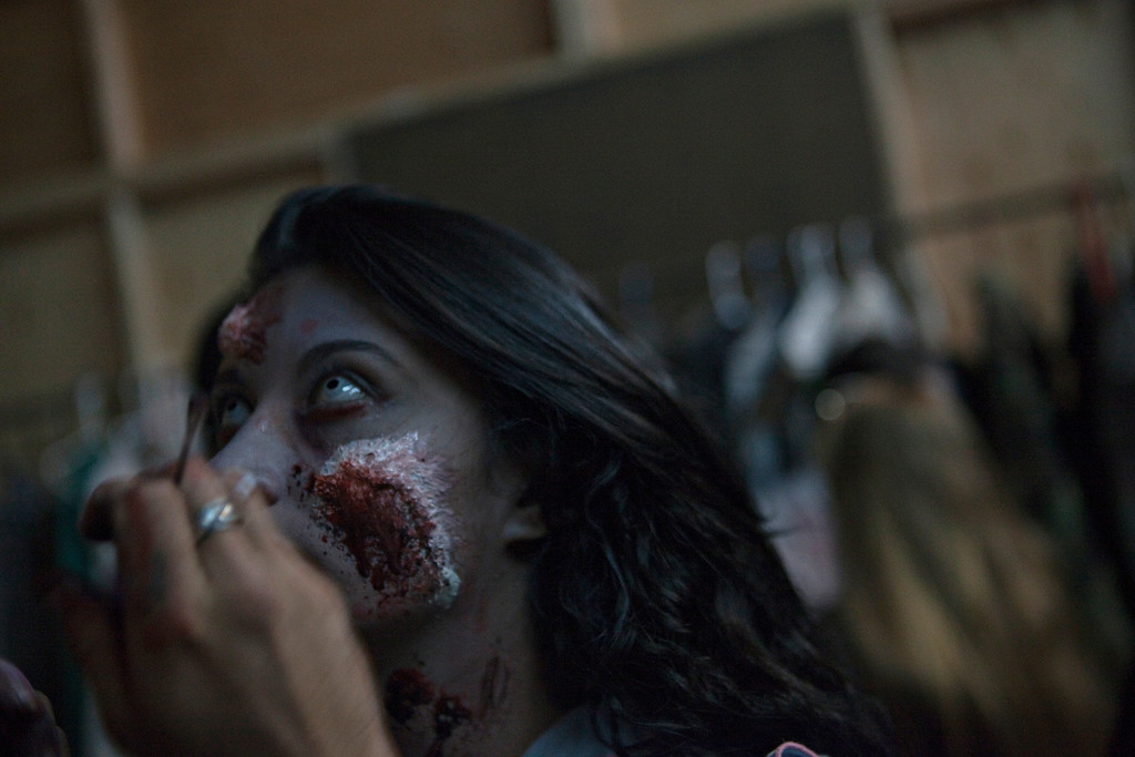 . Actor Eve Delao gets the final touches done on her makeup at The Asylum Haunted House in Denver, Colorado, Saturday, October 19, 2013. Denver haunted houses The Asylum and the 13th Floor are both run by Screamworks Entertainment and have been recognized by MTV, The Travel Channel and USA Today as some of the best haunted houses in the country. (Photo By Katie Wood/The Denver Post)