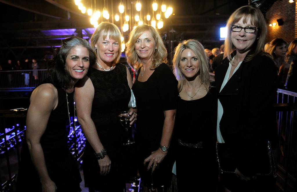 . Left to right: Kristi Keil, Sandi Schiel, Carri Stewart, Jeanelle Roberts and Janet Nessinger at the 28th annual MAX Fashion Show, held at the Mile High Station in Denver on Friday, November 8, 2013. The event is a fundraiser for research at Children\'s Hospital Colorado.  (Photo By Cyrus McCrimmon/The Denver Post)