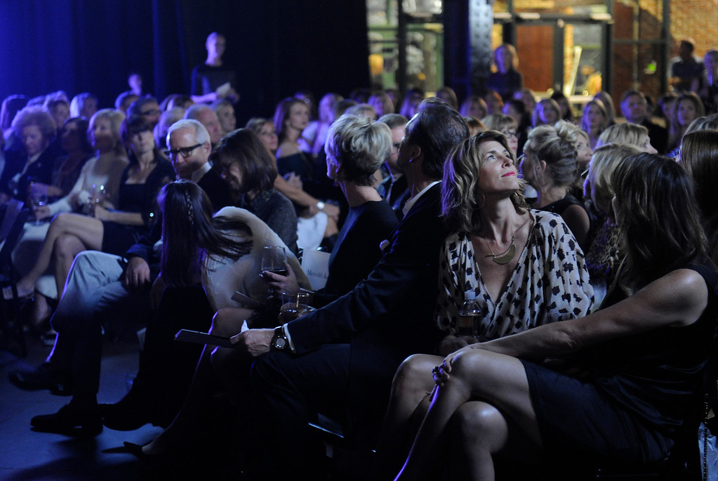 . The audience watches a video tribute to Children\'s Hospital at the start of the 28th annual MAX Fashion Show which was held at the Mile High Station in Denver on Friday, November 8, 2013. The event is a fundraiser for research at Children\'s Hospital Colorado.  (Photo By Cyrus McCrimmon/The Denver Post)