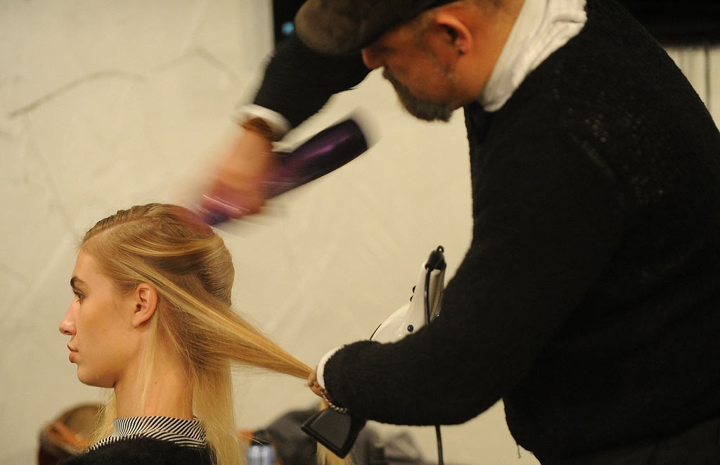 . Hair stylist Steven Trujillo of El Salon puts some energy into the hair of model Katarina Cornakova before the the 28th annual MAX Fashion Show. It  was held at the Mile High Station in Denver on Friday, November 8, 2013. The event is a fundraiser for research at Children\'s Hospital Colorado.  (Photo By Cyrus McCrimmon/The Denver Post)