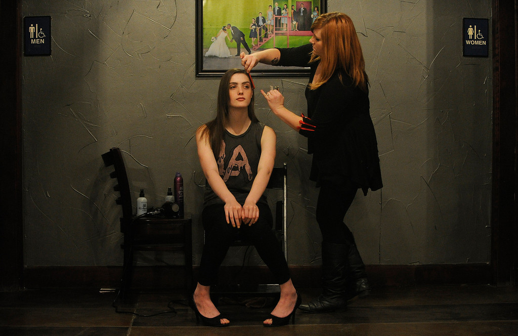 . Model Dani Rose gets her hair done by stylist Andi Mears of El Salon before the the 28th annual MAX Fashion Show. It  was held at the Mile High Station in Denver on Friday, November 8, 2013. The event is a fundraiser for research at Children\'s Hospital Colorado.  (Photo By Cyrus McCrimmon/The Denver Post)