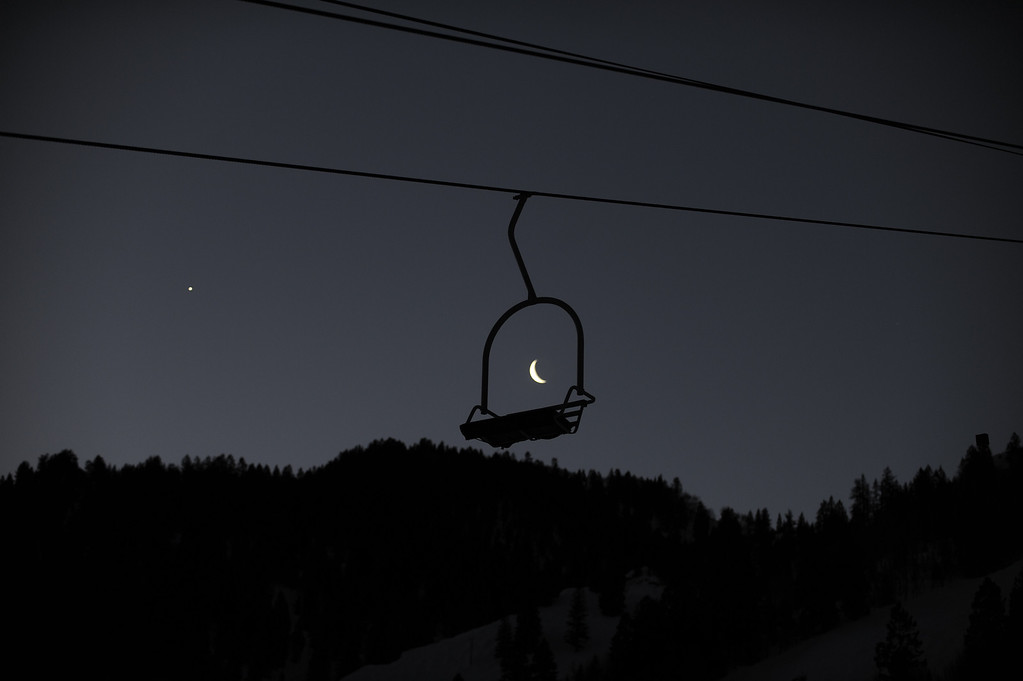 . Seen through the Shadow Mountain Chairlift early in the morning, Saturday, January 29, 201, the moon starts to go down over the Mountains in Aspen, Colorado.  (Photo by RJ Sangosti, The Denver Post)