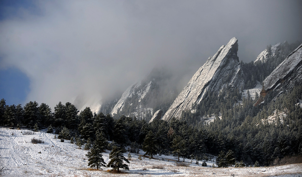 . The Boulder Flatirons were covered with early morning snow as the clouds broke up on March 15, 2010.  Visitors to Chautauqua Park in Boulder, Colorado were greeted with this beautiful drama. (Photo by Cyrus McCrimmon, The Denver Post)