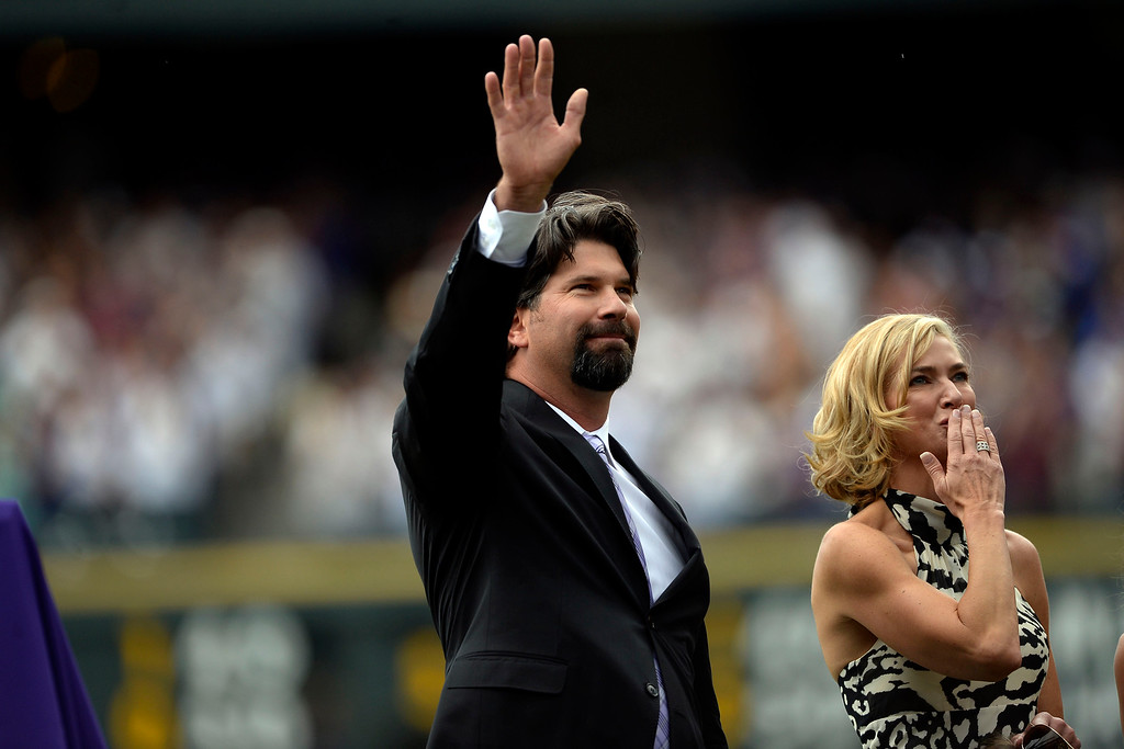 . DENVER, CO - AUGUST 17: Colorado Rockies great Todd Helton waves to the crowd as his wife, Christy, blows a kiss during a retirement ceremony for his number 17. Helton, who played 17 season with the Rockies and holds records for many of the organizations career statistics, was honored on Sunday, August 17, 2014. (Photo by AAron Ontiveroz/The Denver Post)
