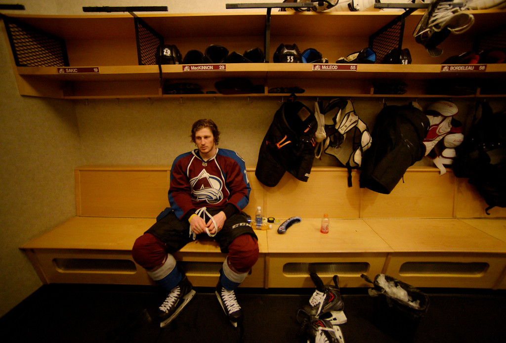 . DENVER, CO - APRIL 30: Colorado Avalanche center Nathan MacKinnon (29) sits at his locker after talking with the media after being defeated by the Minnesota Wild 5 to 4 in overtime. The Colorado Avalanche hosted the Minnesota Wild in the seventh round of the Stanley Cup Playoffs at the Pepsi Center in Denver, Colorado on Wednesday, April 30, 2014. (Photo by John Leyba/The Denver Post)