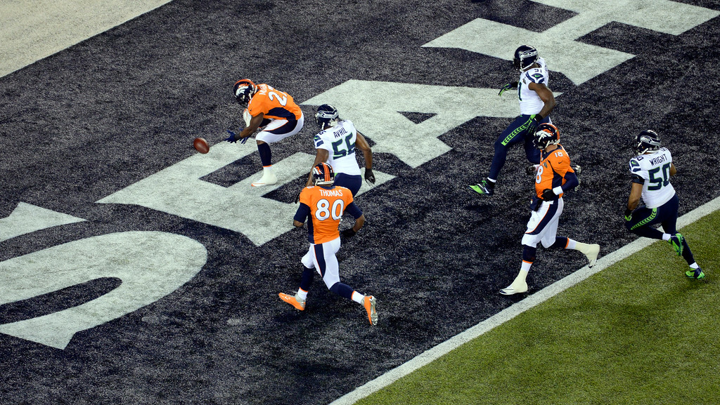 . EAST RUTHERFORD, NJ - FEBRUARY 2: Denver Broncos running back Knowshon Moreno (27) scrambles for the ball during a safety on the opening play.  The Denver Broncos vs the Seattle Seahawks in Super Bowl XLVIII at MetLife Stadium in East Rutherford, New Jersey Sunday, February 2, 2014. (Photo by Craig F. Walker/The Denver Post)