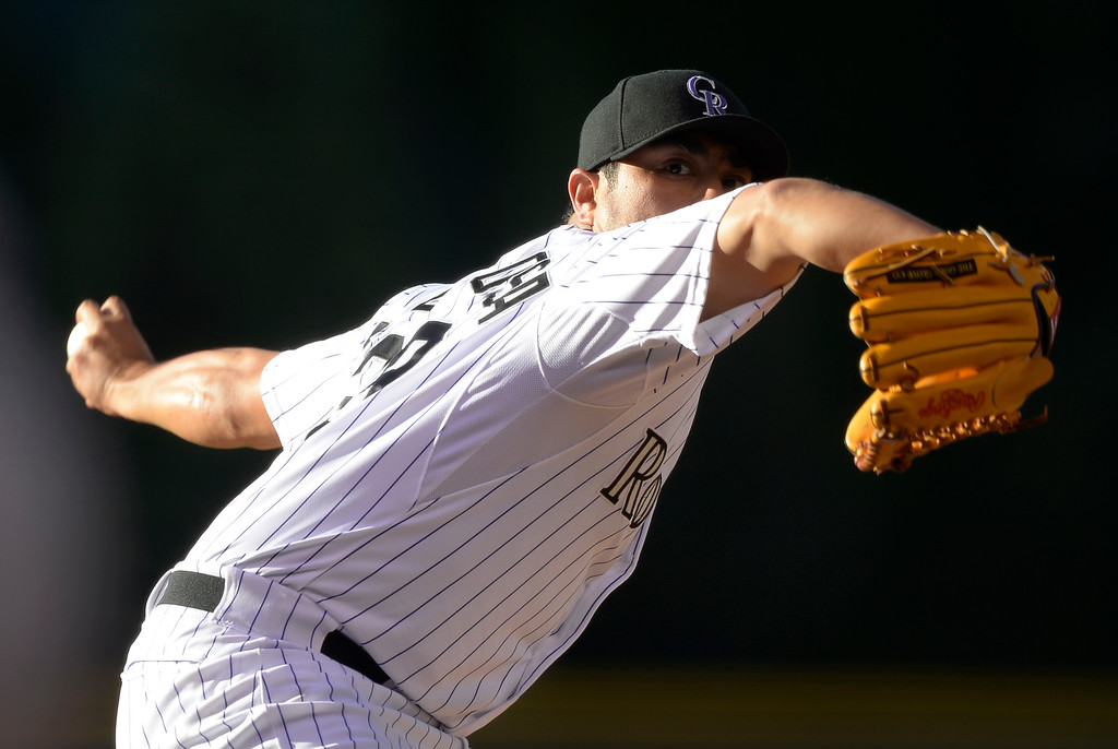 . DENVER, CO - JUNE 03: Colorado Rockies starting pitcher Jorge De La Rosa (29) delivers a pitch against the Arizona Diamondbacks during the first inning June 3, 2014 at Coors Field. (Photo by John Leyba/The Denver Post)