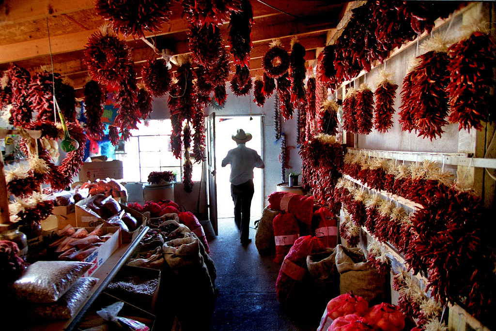 . A local leaves the Hatch Chile Sales store in downtown Hatch, New Mexico.  The store specializes in handmade ristras, chile powders and spices, fresh chiles when they are in season and other chile products.  (Photo By Helen H. Richardson/The Denver Post)
