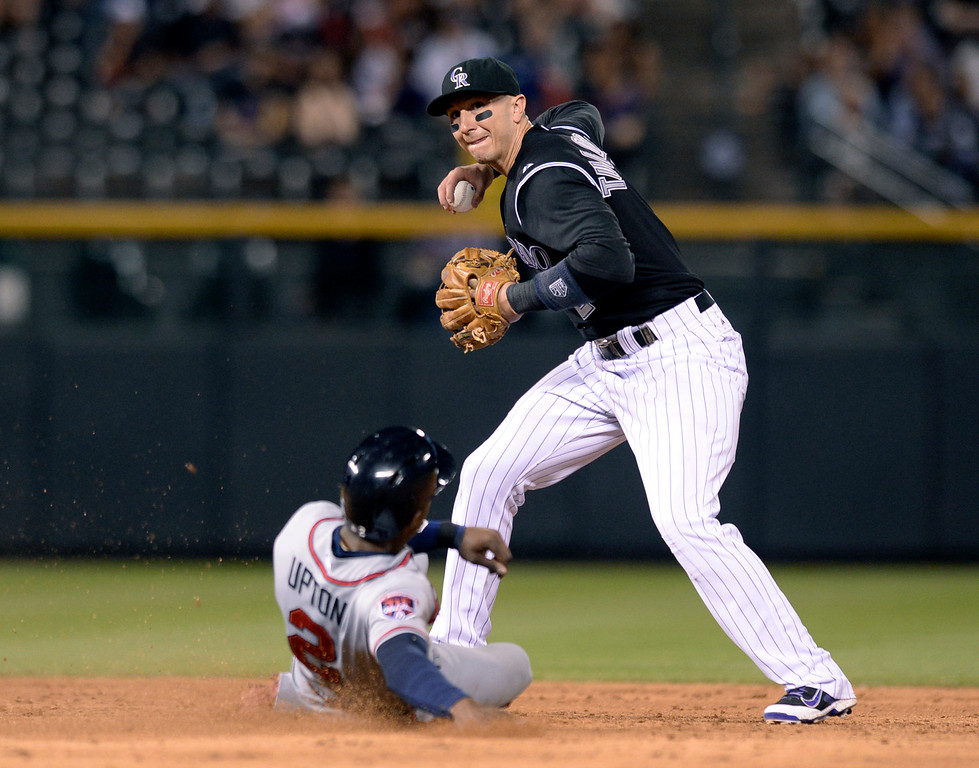 . DENVER, CO - JUNE 10: Colorado shortstop Troy Tulowitzki made a force out on Atlanta baserunner B.J. Upton at second base in the sixth inning. Unfortunately Tulo ran out of time to throw to first sand there was no double play. The Colorado Rockies hosted the Atlanta Braves Tuesday night, June 10, 2014. (Photo by Karl Gehring/The Denver Post)