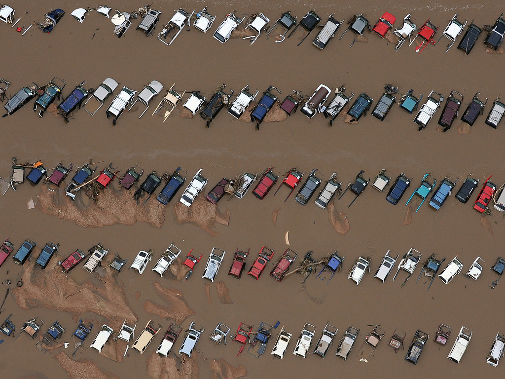 . Cars in a junk yard on 37th street in Evans, Colorado on September 16, 2013. Aerial photographs of the Platte River flooding cities and farms in Weld County Colorado. (Photo By Tim Rasmussen/The Denver Post)
