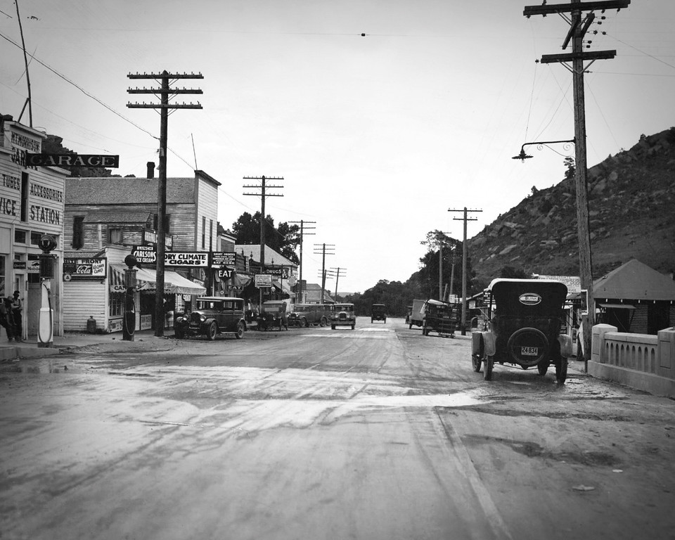 """. Morrison, the key town to Evergreen, Turkey Creek Canyon and other mountain resorts southwest of Denver, are highly pleased with their decision to pave the main street of their town. Before the strip of concrete shown in the picture was laid, Morrison\'s \""""main street\"""" was a problem for motorists during wet Sundays when traffic through the picturesque mountain town was heavy. Motorists no longer avoid passing that way because of a muddy road. (L. Dev. Regnier/The Denver Post Archive)"""