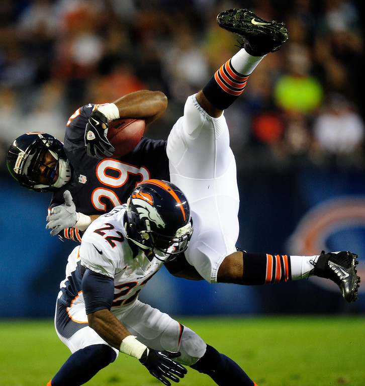 . Denver Broncos defensive back Tracy Porter (22) tackles Chicago Bears running back Michael Bush (29) during the first quarter of their preseason opener at Solider Field in Chicago on Thursday, August 9, 2012. AAron Ontiveroz, The Denver Post