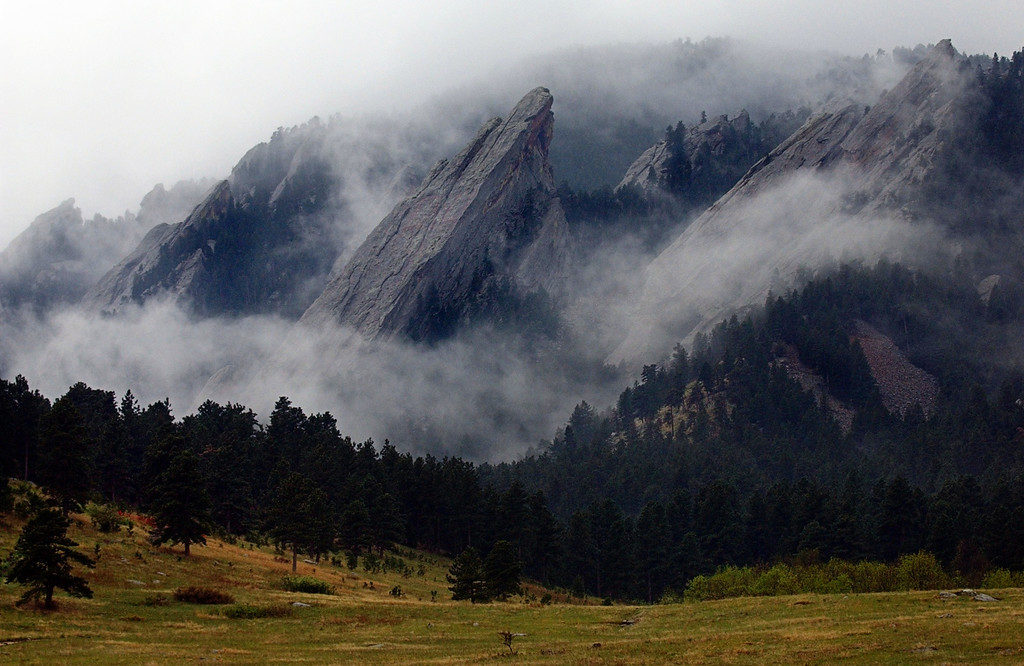 . Under rainy skies and thunder, the Flatirons peek through low cloud cover at Chatauqua Park in Boulder, Colorado on May 16, 2002. (Photo by Kathryn Scott Osler/The Denver Post)