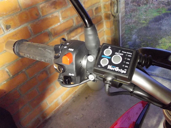 Control unit installed on the handle bars