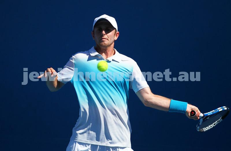 Australian Open 2013. Round 1. Jesse Levine (CAN def  Tommy Robredo (ESP) 7-6 6-7 6-4 6-4 . Photo: Peter Haskin