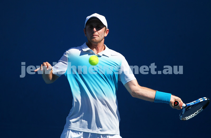 Australian Open 2013. Round 1. Jesse Levine (CAN def  Tommy Robredo (ESP) 7-6 6-7 6-4 6-4 . Photo: Peter Haskin