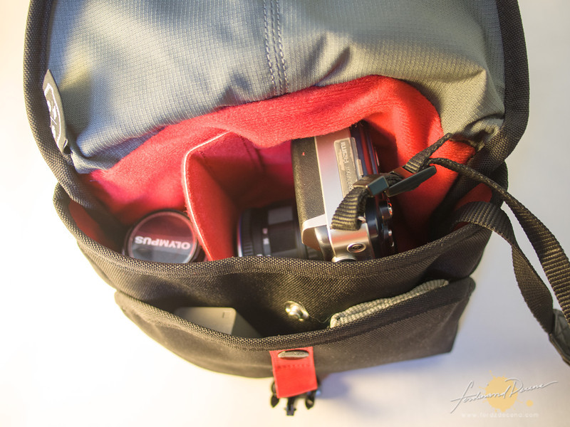 Main compartment with buttoned front pocket