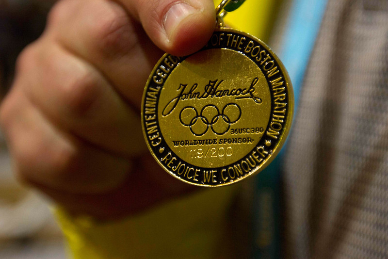 April 12th, 2013 – James Usevich, who has been a volunteer for Boston Athletic Association for 21 years, is wearing a commemorative medal of 1996 Boston Marathon. John B. Hynes Convention Center in Boston, MA is open to public for the 2013 John Hancock Sports & Fitness Expo and Boston Marathon Bib Number Pick-Up. Photo by Xiaolu Liu.