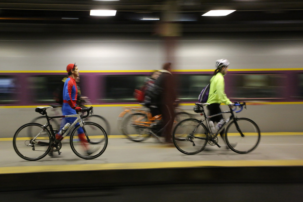 Boston, Mass. April 14- Monty Montana, left, walks his bicycle across the platform at South Station in Boston.  Cyclists met at South Station to take a special train to Hopkinton, Mass.  They biked the entire Boston Marathon route, from Hopkinton to Copley Square the night before the Boston Marathon.  Photo by Hannah Klarner/ Boston University News Service