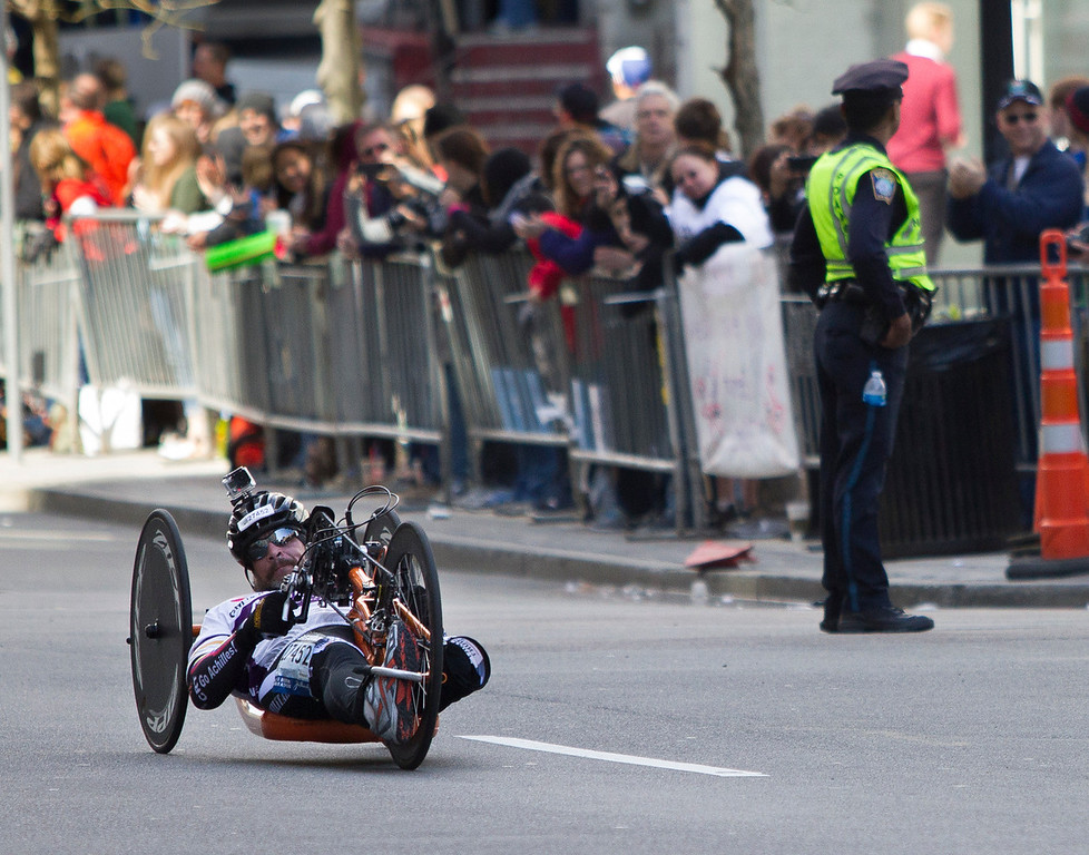 Boston Marathon men's pushrim wheelchair winner Hiroyuki Yamamoto of Japan crossed the finish line at 1 hour  25 minutes and 32 seconds on Monday. (Photo by Micaela Bedell)