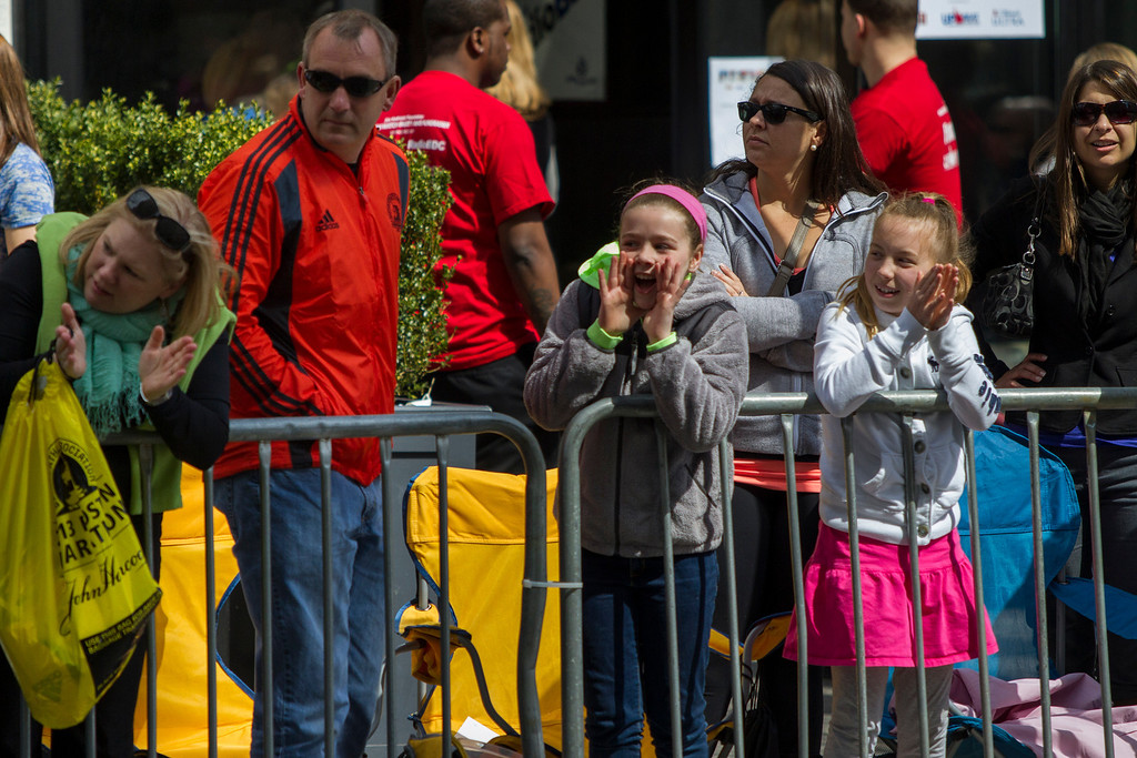 Spectators of the 2013 Boston Marathon on Monday cheered, clapped, and rang bells for competitors only .2 miles from the finish line in Copley Square. (Photo by Micaela Bedell)
