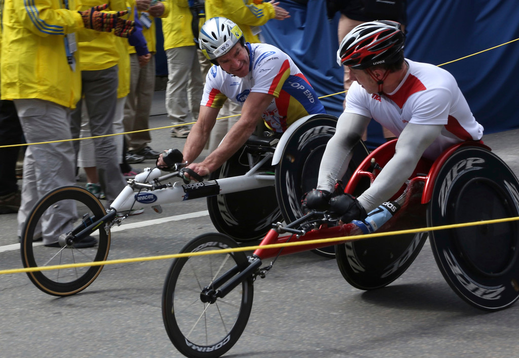Boston, Mass. April 14- Krige Schabort, left, and Tomasz Hamerlak, right, crossed the finish line of Boston Marathon just seconds apart.  No longer competing the two men congratulated each other after finishing the Men's Wheelchair race at the Boston Marathon. Photo by Hannah Klarner/ Boston University News Service