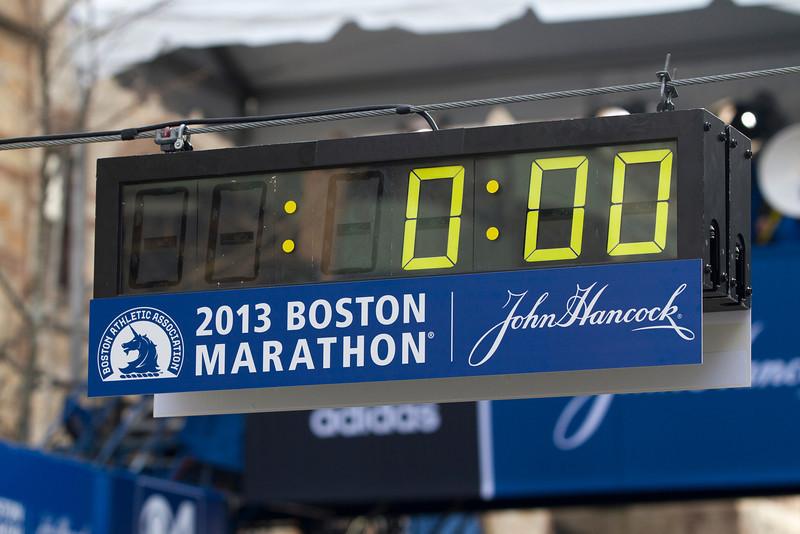 Volunteers set the Boston Marathon finish line clock to zero before competitors leave Hopkinton. (Photo by Micaela Bedell)
