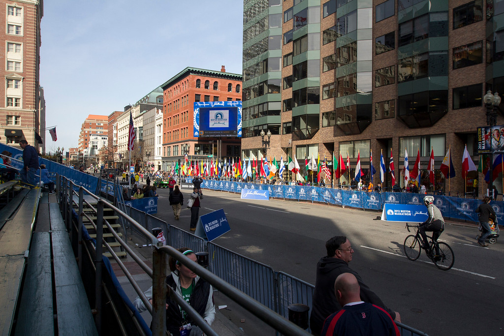 Spectators mill around the Boston Marathon finish line at Copley Square just hours before competitors leave Hopkinton. (Photo by Micaela Bedell)