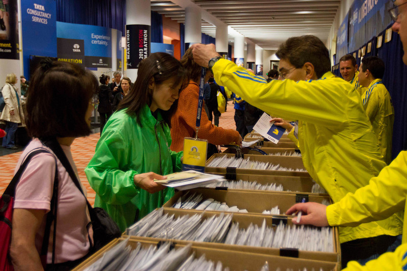 April 12th, 2013 – John B. Hynes Convention Center in Boston, MA is open to public for the 2013 John Hancock Sports & Fitness Expo and Boston Marathon Bib Number Pick-Up. Shinobu Sugiyama from Tokyo, Japan is picking her first Boston Marathon runner's passport up. Photo by Xiaolu Liu. Photo by Xiaolu Liu.