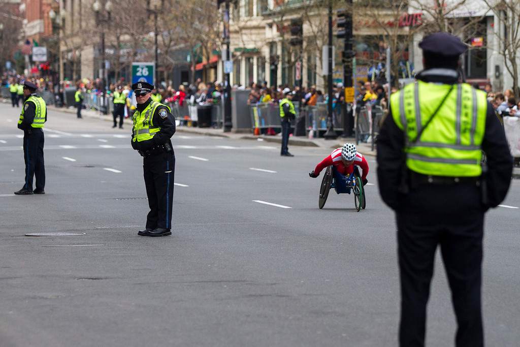 Police officers line the sidewalks near the finish line of the 2013 Boston Marathon. (Photo by Micaela Bedell)