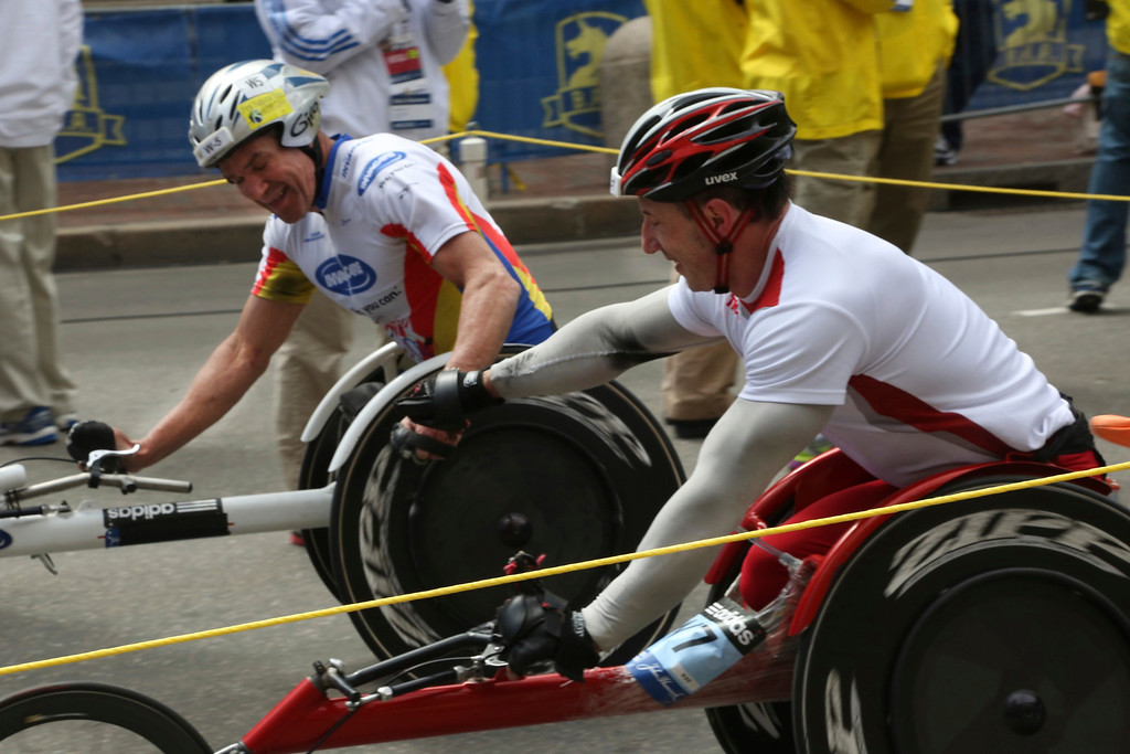 Boston, Mass. April 14- Krige Schabort, left, and Tomasz Hamerlak, right, congratulate each other after crossing the finish line of Boston Marathon.  The two men finished just seconds apart in the Men's Wheelchair competition at the Boston Marathon. Photo by Hannah Klarner/ Boston University News Service