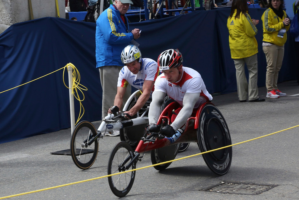 Boston, Mass. April 14- KrigeSchabort, left, and Tomasz Hamerlak, right, crossed the finish line of Boston Marathon just seconds apart.  The men were competing in the Men's Wheelchair event, and finished in just under two hours. Photo by Hannah Klarner/ Boston University News Service