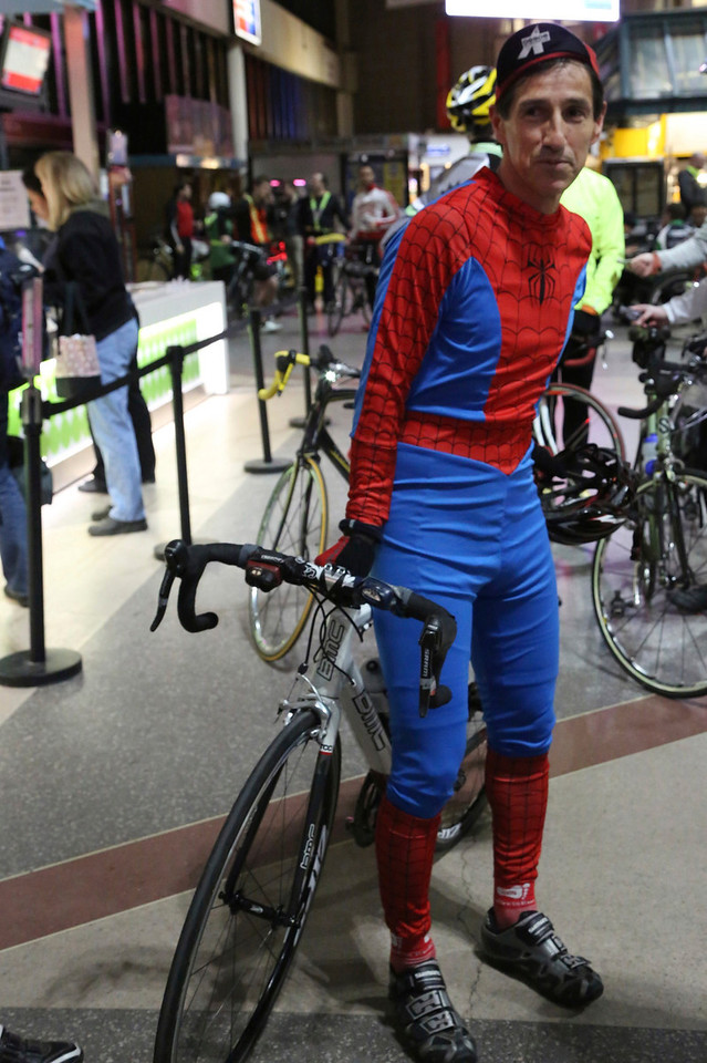 Boston, Mass. April 14- Monty Montana dressed in a Spiderman costume to participate in the annual Midnight Bike Marathon in Boston.  A professor at Boston University, Montana was a first time rider.  The event drew over 700 cyclists who completed the Boston Marathon course on bikes the night before the event.  Photo by Hannah Klarner/ Boston University News Service