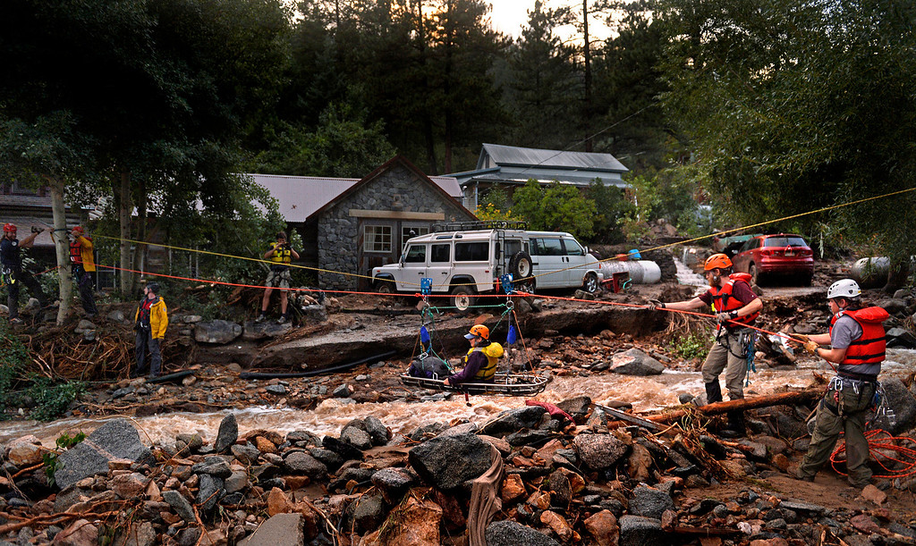 . The Alpine Rescue Team uses a high line and a sling stretched across Four Mile Canyon to rescue Darian Shaw from her Salina home. Shaw and three neighbors were brought across the rushing water. The Alpine Rescue Team, Four Mile Fire and Rocky Mountain Rescue Team worked to get people out after heavy rains caused flash flooding and washed away most of the town.