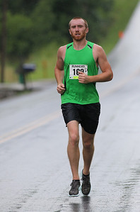 Timothy Kelly of Lakewood placed 2nd overall in the Columbia Station half marathon run and skate. Shown here on Crocker Road with just over 3 miles miles to go. photo by Ray Riedel
