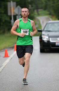 Timothy Kelly of Lakewood placed 2nd overall shown here at the finish of the Columbia Station half marathon run and skate. photo by Ray Riedel