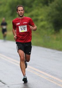 Michal Orzel of Oberlin, OH is in 3rd place overall with over three miles to go in the Columbia Station half marathon run and skate. photo by Ray Riedel