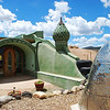 Earthship home.  They look very Star Wars Tantooine-ish, but they are built from recycled materials and they are self supportive.  I can live with that.
