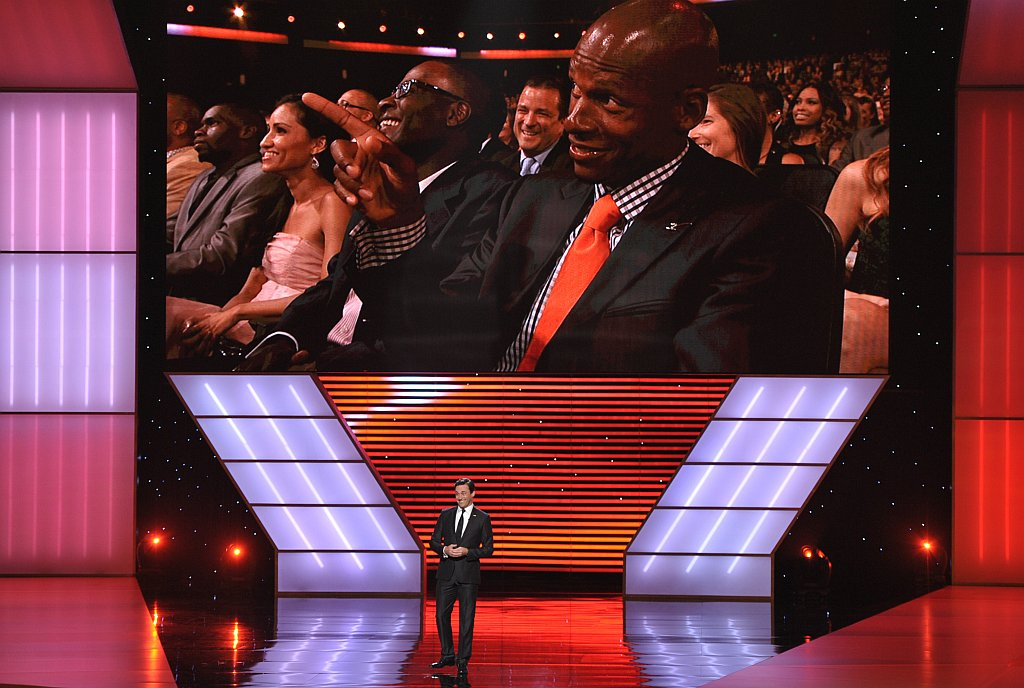 . Jon Hamm speaks on stage at the ESPY Awards on Wednesday, July 17, 2013, at Nokia Theater in Los Angeles. NBA player Ray Allen is seen on the screen. (Photo by John Shearer/Invision/AP)