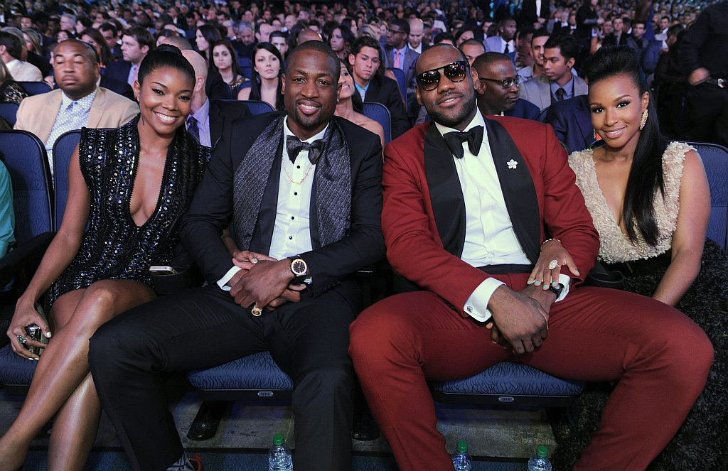 . Gabrielle Union, left, and Dwyane Wade, center, LeBron James and Savannah Brinson are seen in the audience at the ESPY Awards on Wednesday, July 17, 2013, at the Nokia Theater in Los Angeles. (Photo by Jordan Strauss/Invision/AP)