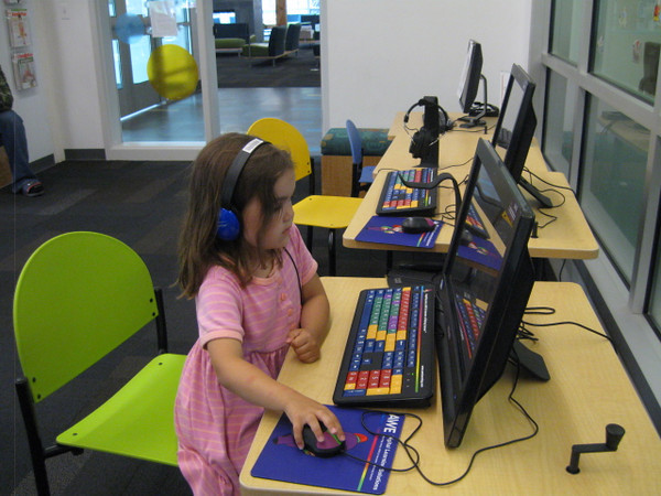 Playing a computer game at the Kenai Community Library.
