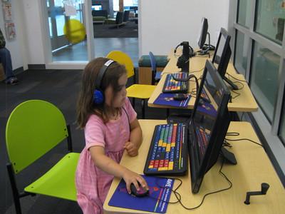 Playing a computer game at the Kenai Community Library.