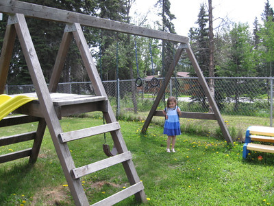 Braving the mosquitoes to play in the church playground.