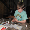 On Sunday, May 26 I picked Hugh up at the Hope junction.  He'd been camping with his parents.  Hugh works on a Lego set following the instructions.