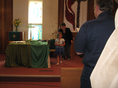 Hilary got to visit on her own June 22-26.  Here she has just finished extinguishing the altar candles.