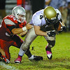 Fitchburg High School played Shrewsbury High School on Friday night in Fitchburg. FHS players Mike Duprey and Gaston Pastorino tackle SHS Jakob McVane. FHS Anthony Diprima holds on to SHS's Nicholas Diliberto as he tries to take him down during action in the game. SENTINEL & ENTERPRISE/ JOHN LOVE