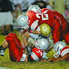 Fitchburg High School played Shrewsbury High School on Friday night in Fitchburg. FHS players Mike Duprey and Gaston Pastorino tackle SHS Jakob McVane. Many FHS players tackle a SHS player during action in the game. SENTINEL & ENTERPRISE/ JOHN LOVE