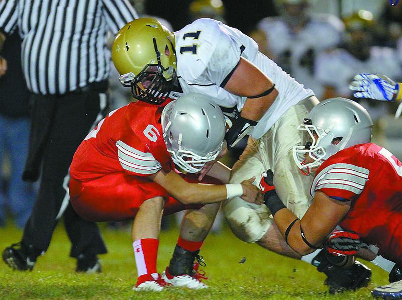 Fitchburg High School played Shrewsbury High School on Friday night in Fitchburg. FHS players Mike Duprey and Gaston Pastorino tackle SHS Jakob McVane. SENTINEL & ENTERPRISE/ JOHN LOVE