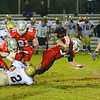 Fitchburg High School played Shrewsbury High School on Friday night in Fitchburg. FHS players Mike Duprey and Gaston Pastorino tackle SHS Jakob McVane. FHS's Anthony Diprima is taken down by SHS's Maxim Najarian. SENTINEL & ENTERPRISE/ JOHN LOVE