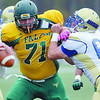 Fitchburg State Football team played Worcester State on Saturday at home. WSU player #61 Zachary Pappas tries to block FSU's James Veradt  but he has his eyes set on getting WSU QB Kevin Bumpus. SENTINEL & ENTERPRISE/ JOHN LOVE